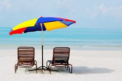 Beach with chairs and umbrella Stock Image