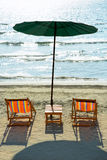 Beach chairs and umbrella on beach. Stock Photography