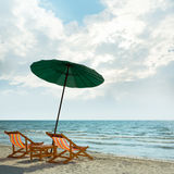Beach chairs and umbrella on beach. Royalty Free Stock Photography