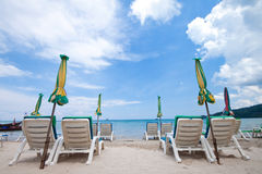 Beach chairs with umbrella and beautiful beach Stock Photos