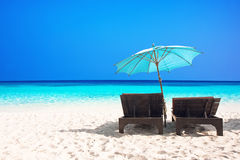 Beach chairs with umbrella. And beautiful sand beach Stock Images