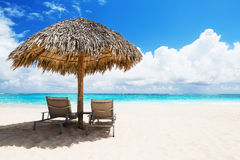 Beach chairs with umbrella and beautiful sand beach Royalty Free Stock Images