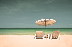 Beach chairs with umbrella Royalty Free Stock Photography