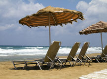 Beach chairs and umbrella Royalty Free Stock Photos