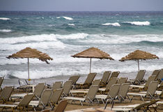 Beach chairs and umbrella Royalty Free Stock Images