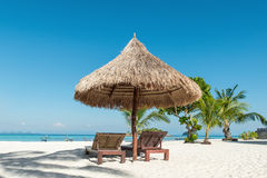 Beach Chairs and Umbrella on island in Phuket, Thailand Royalty Free Stock Photos