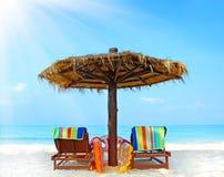 Beach chairs with umbrella Stock Photos