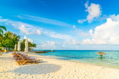 Beach chairs with umbrella at Maldives island, white sandy beach Royalty Free Stock Photo