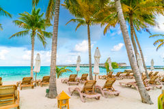 Beach chairs with umbrella at Maldives island, white sandy beach. And sea royalty free stock photography