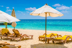 Beach chairs with umbrella at Maldives island, white sandy beach Stock Image