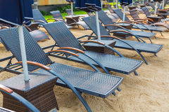 Beach chairs and umbrella Stock Image