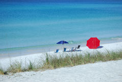 Beach Chairs and Umbrella on the Sand Stock Photo
