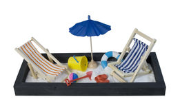 Beach chairs with umbrella and shovel and pail Royalty Free Stock Photos