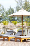 Beach chairs and umbrella side swimming pool Royalty Free Stock Photo