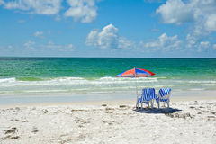 Beach Chairs with Umbrella Stock Photo