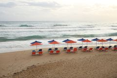 Beach chairs and umbrellas on beach stock image