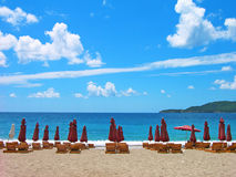 Beach with chairs and umbrellas. Beautiful empty beach with chairs and umbrellas Stock Images