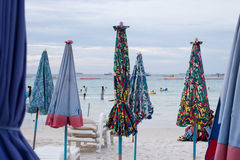 Beach chairs and umbrellas Stock Photography