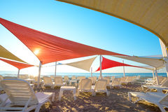 Beach chairs and umbrellas. On the beach stock photos