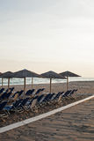 Beach chairs and umbrellas on the beach. Royalty Free Stock Images