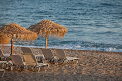 Beach chairs and umbrellas on the beach. Stock Images
