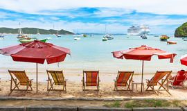 Beach chairs and umbrellas on beach in Buzios, Rio de Janeiro Stock Photos