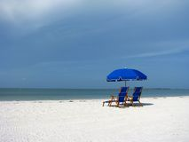 Beach Chairs and Umbrellas on the Beach Stock Images