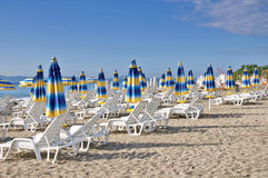 Beach chairs and umbrellas Royalty Free Stock Photos