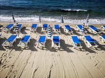 Beach lido ready for summer. Beach chairs and umbrellas at a lido ready for summer royalty free stock images