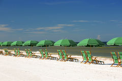 Beach chairs and umbrellas lined up on the beach Stock Images