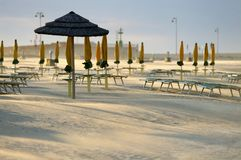 Beach chairs and umbrellas. Rimini Beach just before sunset, Emilia Romagna, Italy royalty free stock photos