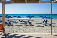 View of beach chairs with umbrellas Royalty Free Stock Images