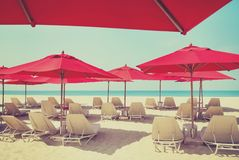 Beach chairs and umbrellas on a sand beach Stock Photography
