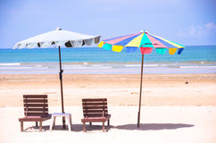 Beach chairs and umbrellas on sand beach. Take relaxing on sand beach Stock Images