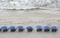 Beach chairs and  umbrellas in the sand Stock Photo