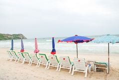 Beach chairs and umbrellas Stock Photos