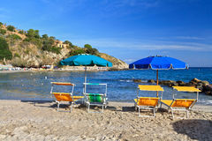 Beach chairs and umbrellas Royalty Free Stock Images