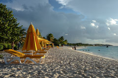Beach chairs and umbrellas at sunset, Shoal Bay East, Anguilla, British West Indies, BWI, Caribbean Royalty Free Stock Images
