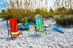 Beach Chairs with Umbrellas Stock Images
