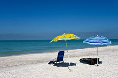 Beach Chairs with Umbrellas Royalty Free Stock Images