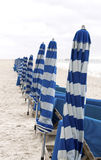 Beach chairs and unbrellas Stock Image