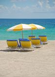 Beach chairs under umbrellas Stock Photography