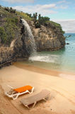 Beach chairs by waterfall Royalty Free Stock Photos