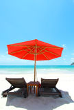 Beach chairs white sand Royalty Free Stock Images