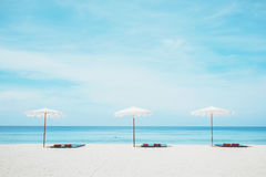 Beach chairs on the white sand beach. And blue sea stock photo