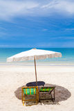 Beach chairs on the white sand beach Royalty Free Stock Image
