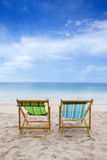Beach chairs on the white sand beach Stock Image