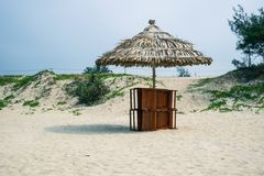 Beach chairs on the white sand beach with cloudy blue sky and sun Royalty Free Stock Photos