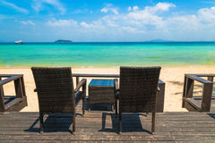 Beach chairs on the white sand beach at summer terrace restauran Stock Photo
