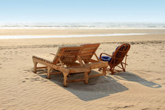 Beach chairs on the white sand beach Royalty Free Stock Images
